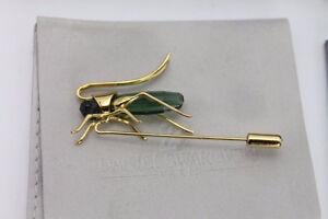 Retired Daniel Swarovski Paradise Aptera Chrysolite Grasshopper.