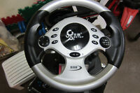 """ BETOP NEW STEERING WHEEL FOR PC/SONY PS3. TEL. 514-996-9207"