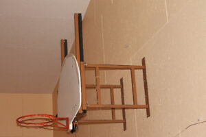 2 wall-mount basketball hoops and backboards