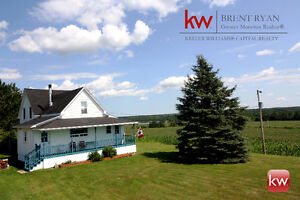 On the Richibucto River with detached garage & 85 Acres of land!