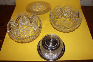 Lot of crystal serving/punch bowls & a glass bowl