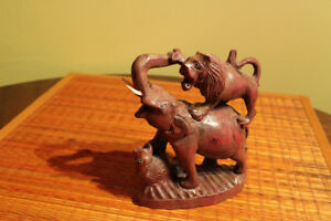 Hand crafted, carved in wood animal statue.