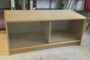 Blonde wood entertainment stand with glass doors