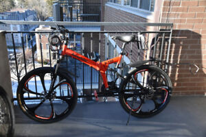 """21 speed, 26"""" tires, folding mountain bike for sale."""