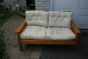 Sofa. Solid wood. Clean White Pads and Pillows.