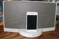 White Bose sounddock and white iPod touch combo