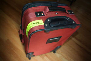 Via Rail Carry on luggage in burnt orange purchased at the Bay Kitchener / Waterloo Kitchener Area image 1