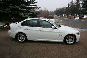 2011 BMW 3-Series, X-Drive Manual 6 speed Low KM's private sale