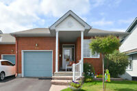 SUN-FILLED 2-BEDROOM END-UNIT ADULT-STYLE BUNGALOW IN ORLEANS