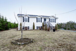 Raised bungalow with views of Lawrencetown Lake and Ocean.