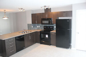 Two Master Bedroom Townhouse IN SUMMERSIDE ON REDUCED PRICE