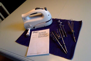 Oster mixer with attachements and instruction book