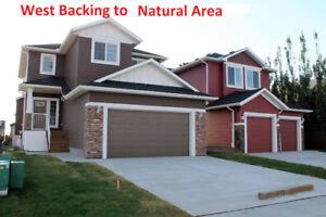 CROSSFIELD, Alberta!   Triple Garage, W/Out, Lane  $399,900 +