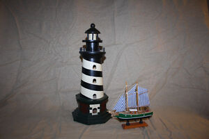 Lighthouse and Small Ship