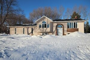Great country property! Located west of Carman, MB