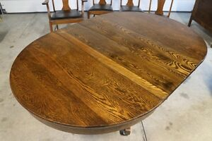 Antique round oak pedestal table and chairs