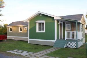 maison mobile 12x58 avec 2 rallonges sur les cotés terrain privé