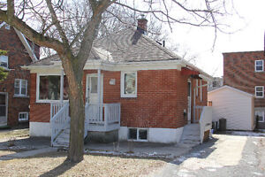 Bright and cozy brick bungalow close to downtown and Queen's