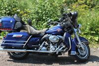 Beautiful metalic blue 2007 Harley ready for touring