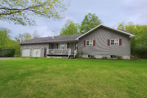 3+2 bdrm bungalow set in the trees on 26+ acres min from Ptbo
