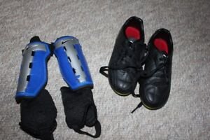 Soccer cleats (size 12) and shin pads with ankle guards