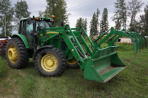 ESTATE SALE John Deere 7520 with loader and Grapple