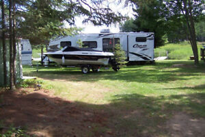 32' Cougar House trailer Also the Grew 17 ft. Boat inboard outbo