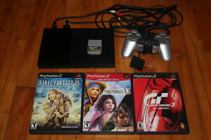 Playstation 2 slim + 1 manette + 3 jeux