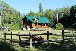 BEAUTIFUL LOG HOME ONLY 20 MINUTES NORTH OF THE CITY