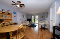 ***STUNNING 2 BEDROOM CONDO BY THE RIVER***