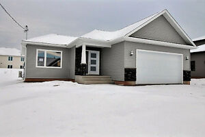 New Bungalow with attached garage for sale in Grove Hamlet!