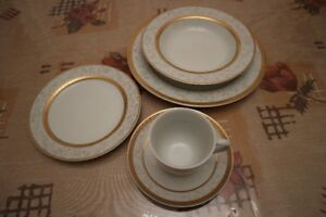 Gold Dish set plus crystal glasses and set of cutlery