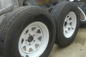 TWO  ST 225-75-R 15 INCH TIRES AND 4 ST 205-75-R 15 INCH