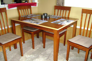 Dining table of solid wood, no veneer and 4 chairs
