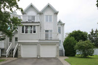 Renovated End Unit backing onto Green space