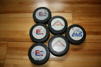 Lot of 4 1980's AHL game-used hockey pucks