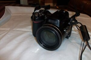 NIKON 8.9-89MM 10X ZOOM AND MOVIES ALSO WITH CARRYING CASE