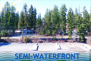 Semi-waterfront lot in Magna Bay - shared private beach access!