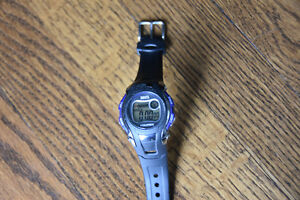 Roots Digital Watch , Brand new never worn. Black with blue trim