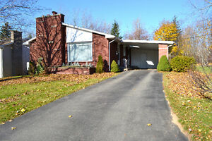 BRICK BUNGALOW WITH CARPORT AND PRIVATE BACKYARD IN DIEPPE!