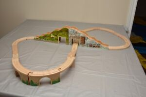 Wooden train tracks and stations