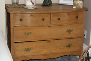 antique oak dresser with heavy bevel mirror and curved front