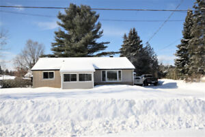 Cozy 3 bed, 1 bath home on large lot with single detached garage