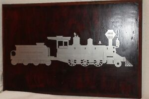 cut out of steel, train on solid wood plaque