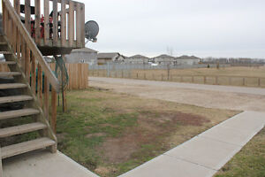 Suite back onto large open field for rent June 1!