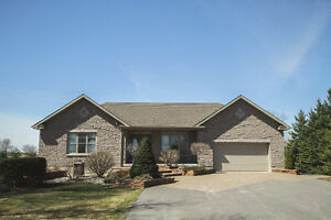 A beautiful high end country home with 3 bay shop/garage & loft!