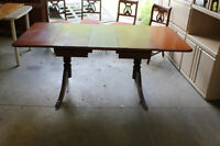 Krug Brothers Drop leaf table, with built in leaf and 4 chairs