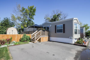 AFFORDABLE ONE LEVEL LIVING... FULLY FINISHED 2 BED HOME