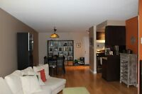 Bright 2 bedroom condo with indoor parking