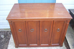 SOLID WALNUT CABINET WITH FOLDING DOORS FLAT SCREEN TV. ECT.